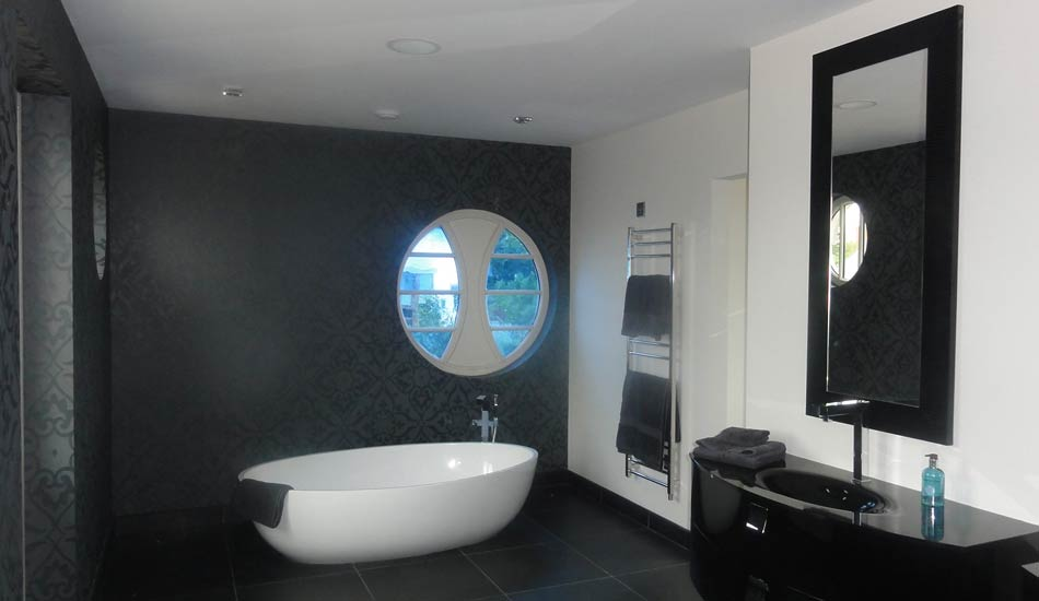 Painting and wallpaper hanging in a luxury bathroom by Total Paintworks Ltd., Decorators, Kerry, Ireland